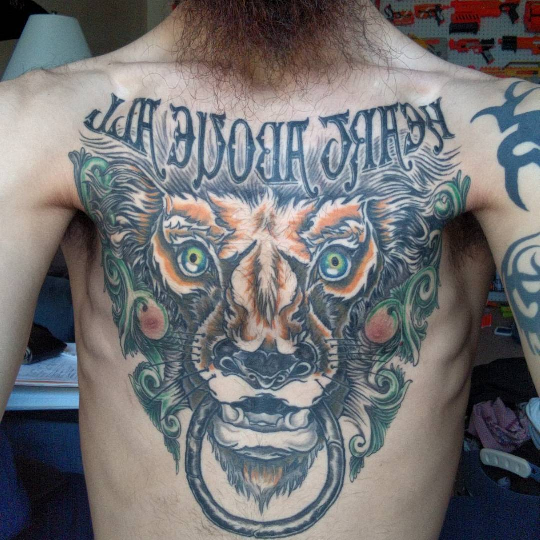 Full Chest Tattoo of Lion Dragon