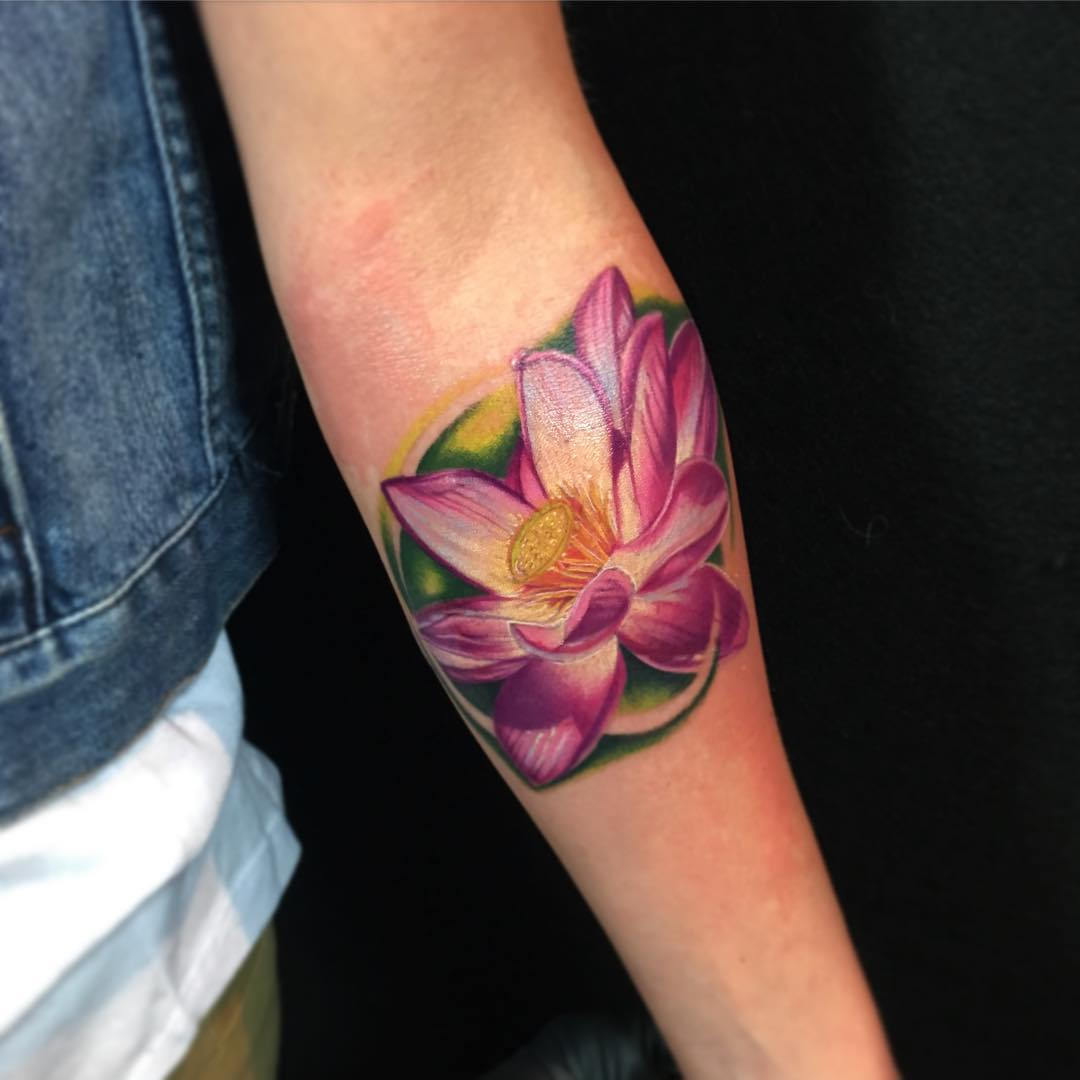 pink lotus flower hand tattoo