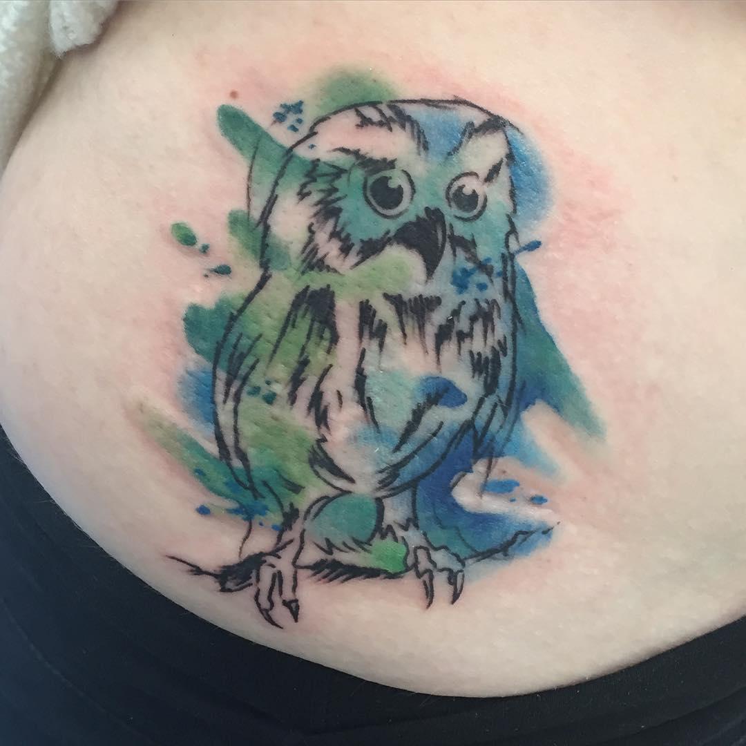baby owl tattoo on hip