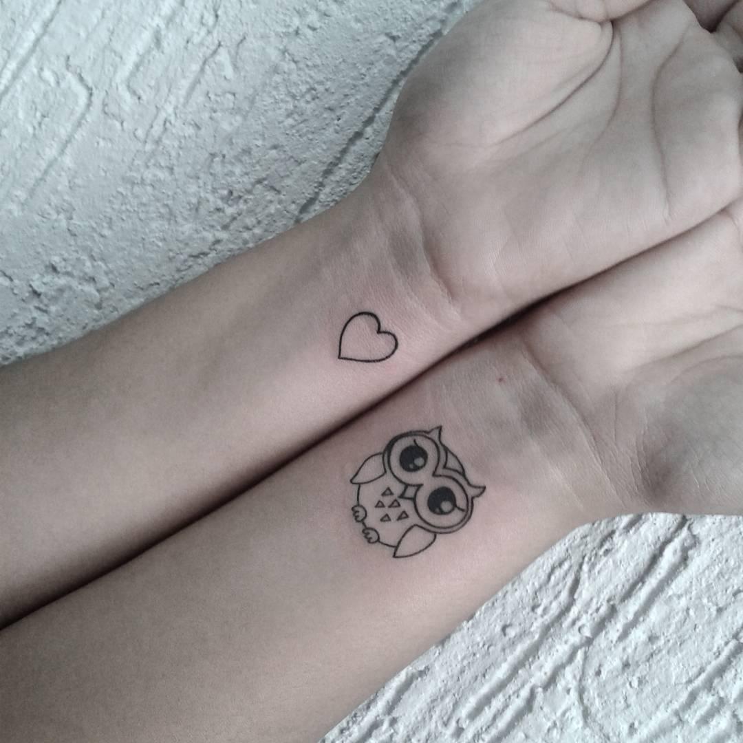 Small Baby Owl Wrist Tattoo.