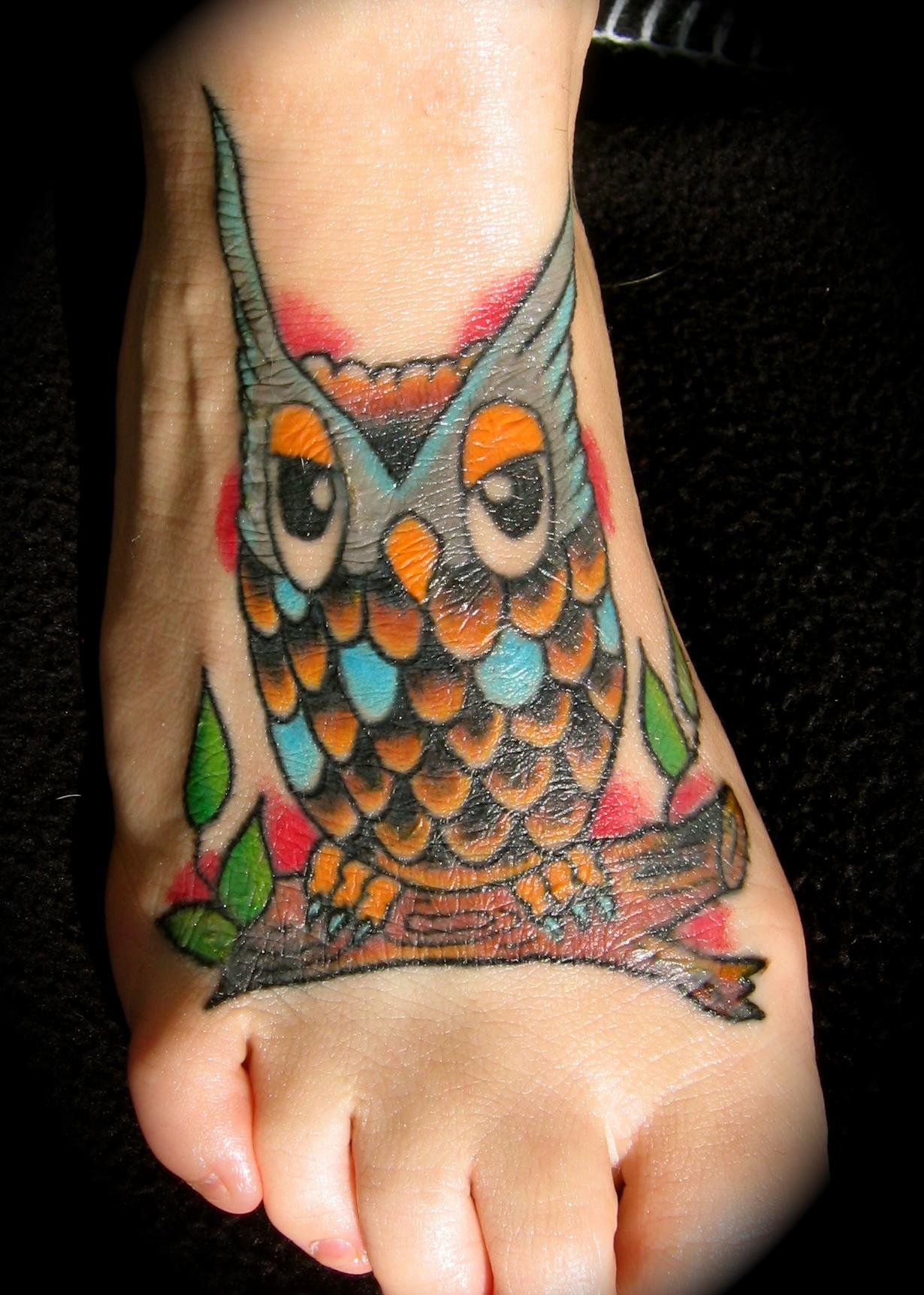 simple owl tattoo design on leg
