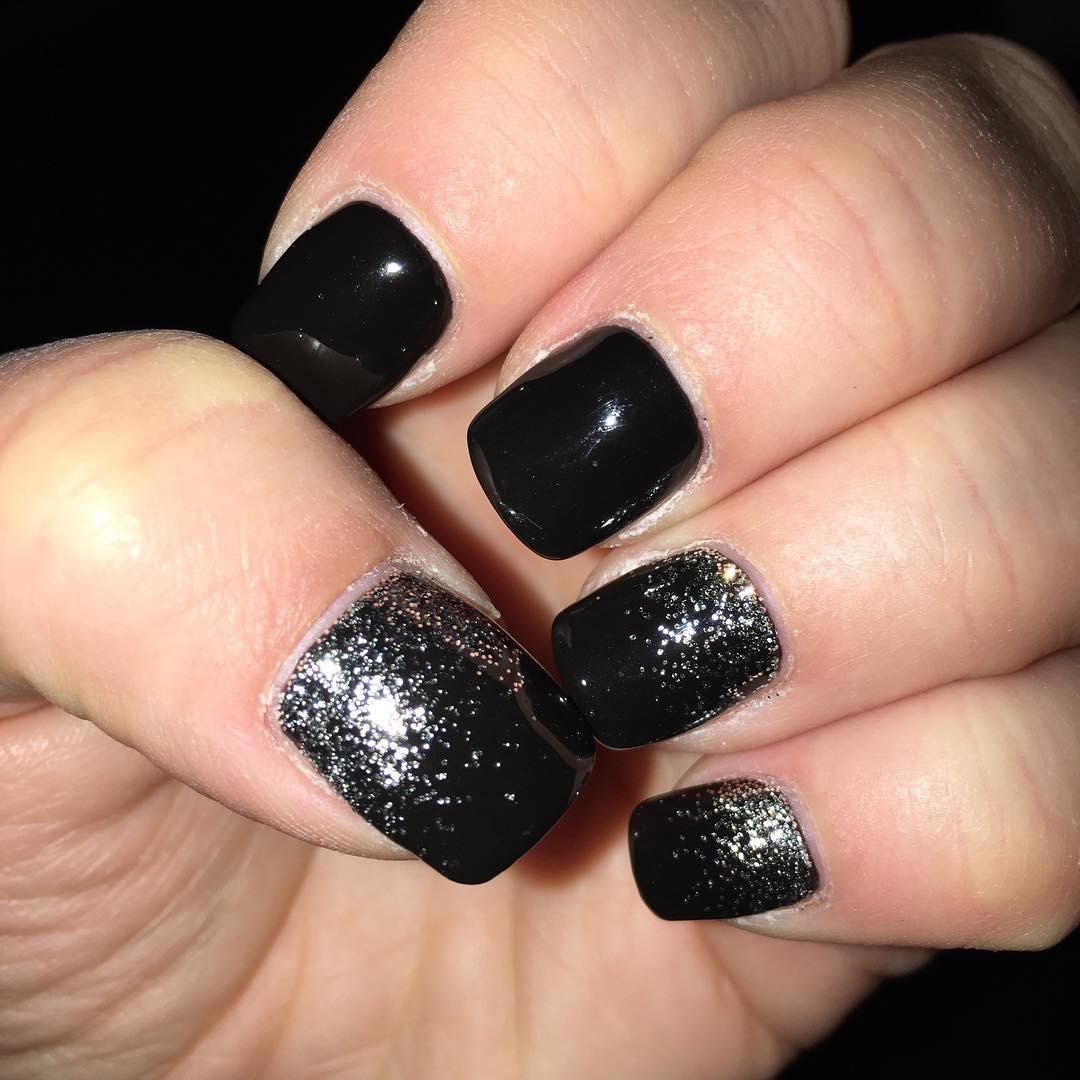 trendy black and silver glitter nail design for parties
