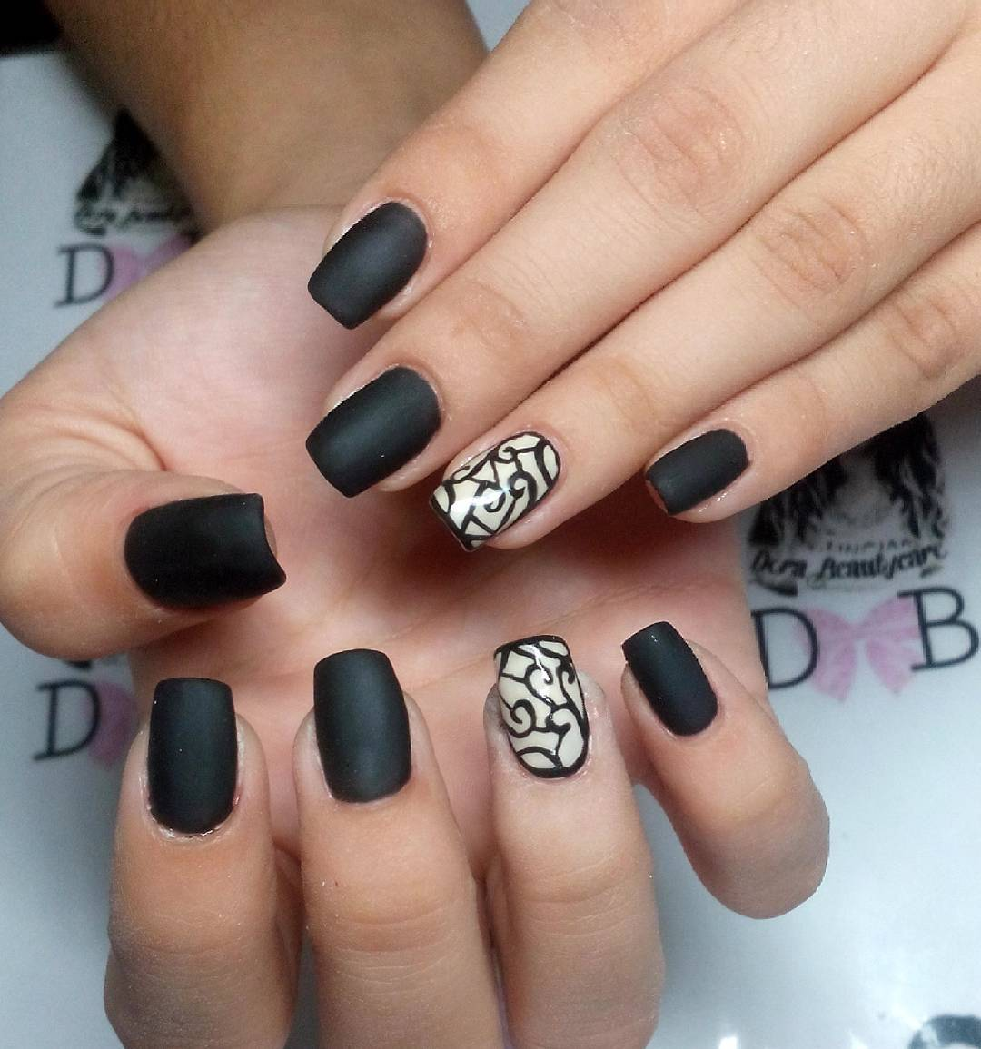 designed black nail art for women