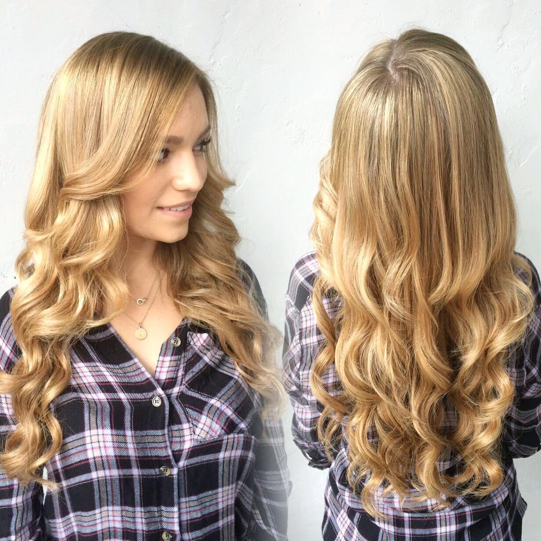 Honey blonde hair medium curly