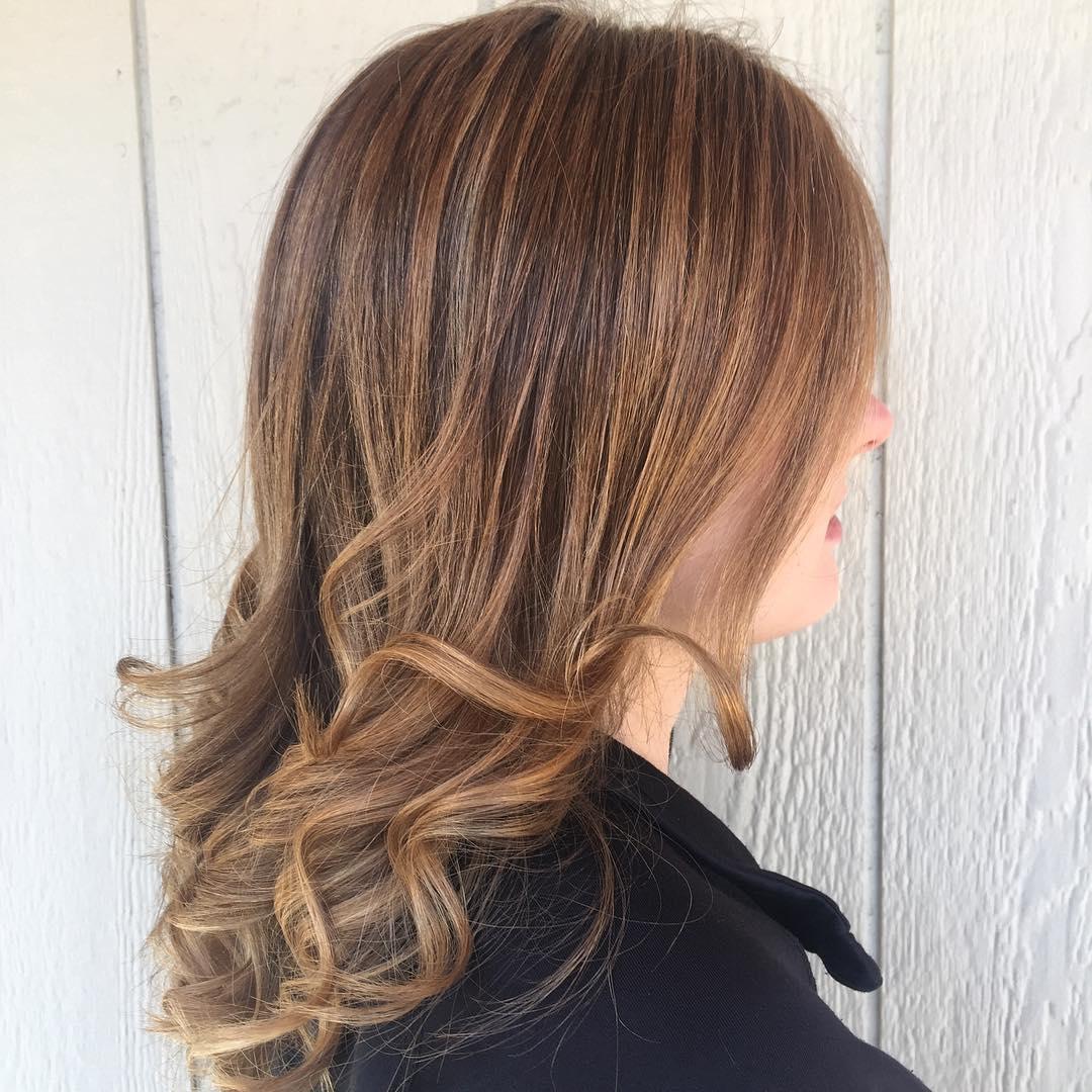 Honey blonde medium shadey bangs hairdo
