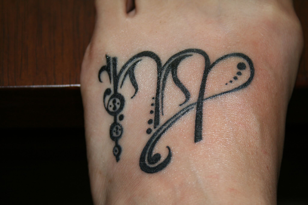 Tattoo of Virgo on Foot
