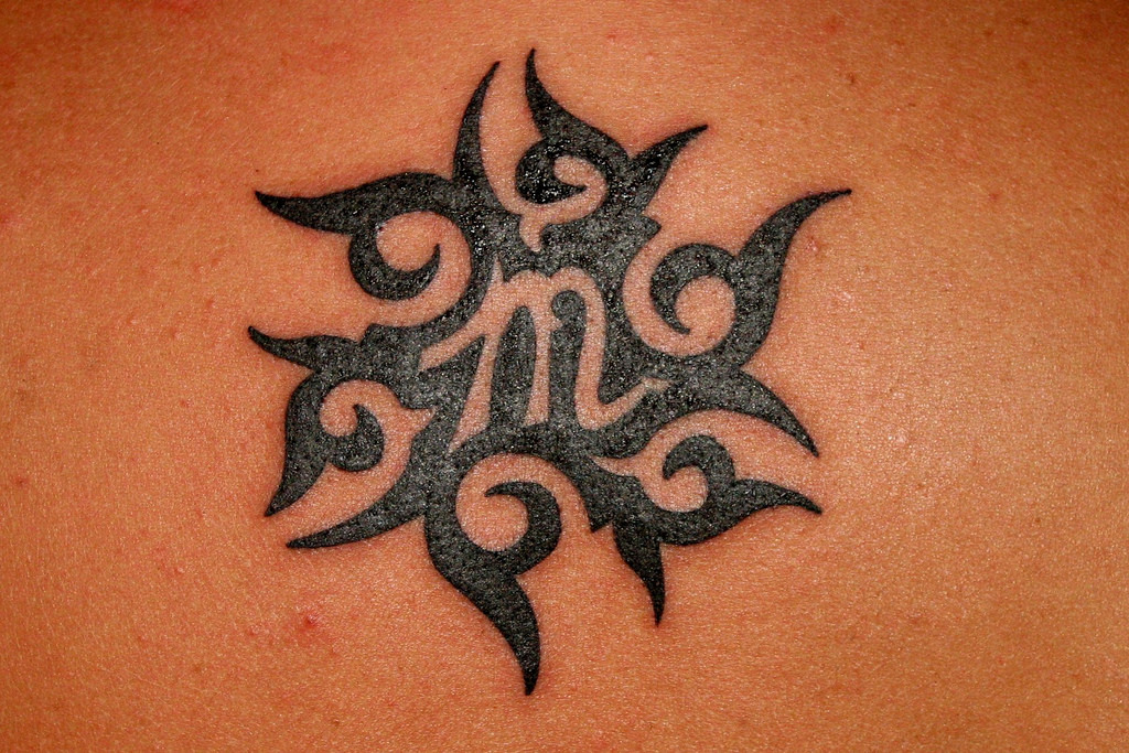 Tribal Tattoo Symbol: Stylish And Unique Virgo Tattoo Design Ideas