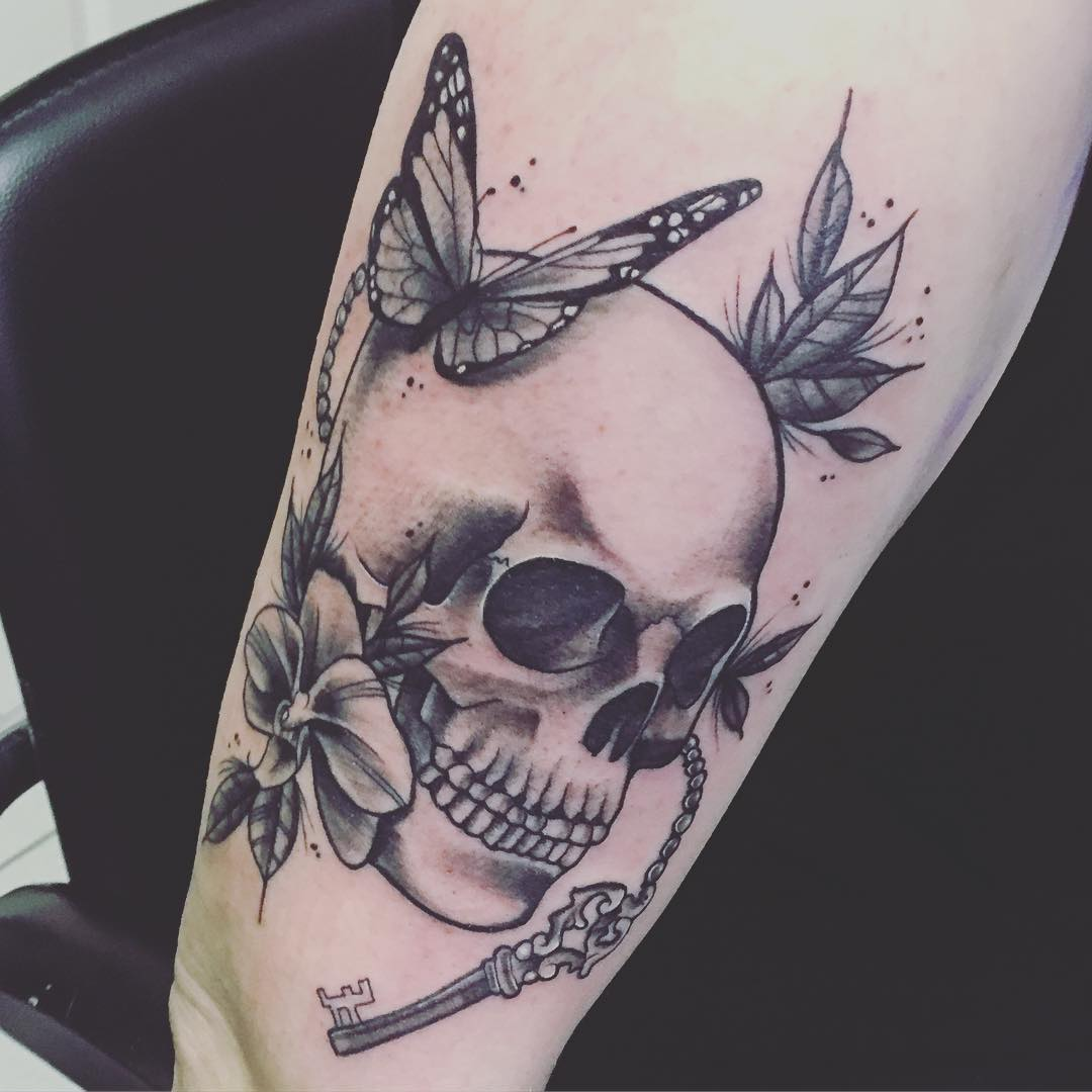 skull and key design tattoo on hand