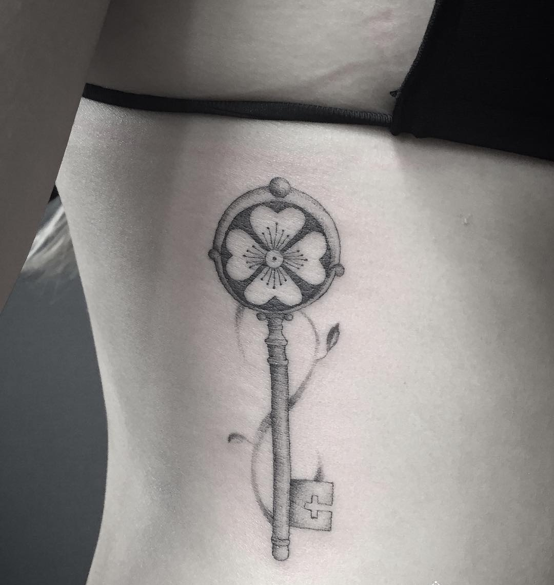 flower key tattoo on hip for girls