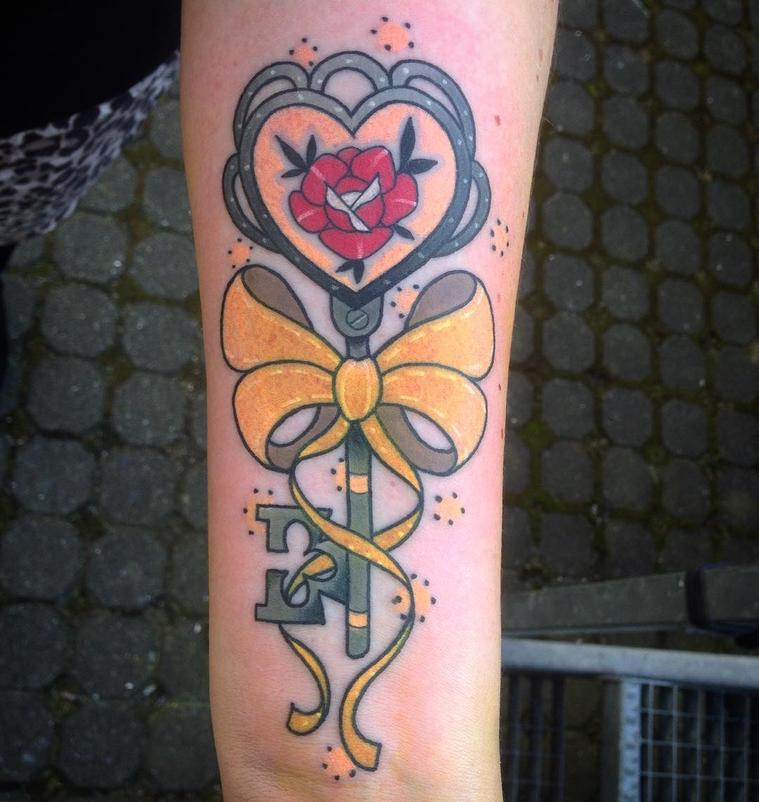 ribbon and key tattoo on hand