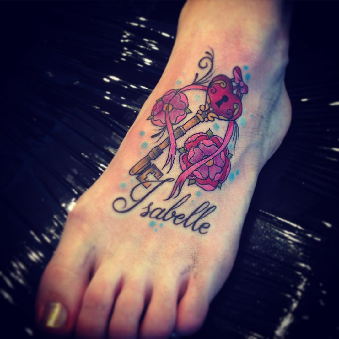 tudor rose and key foot tattoo