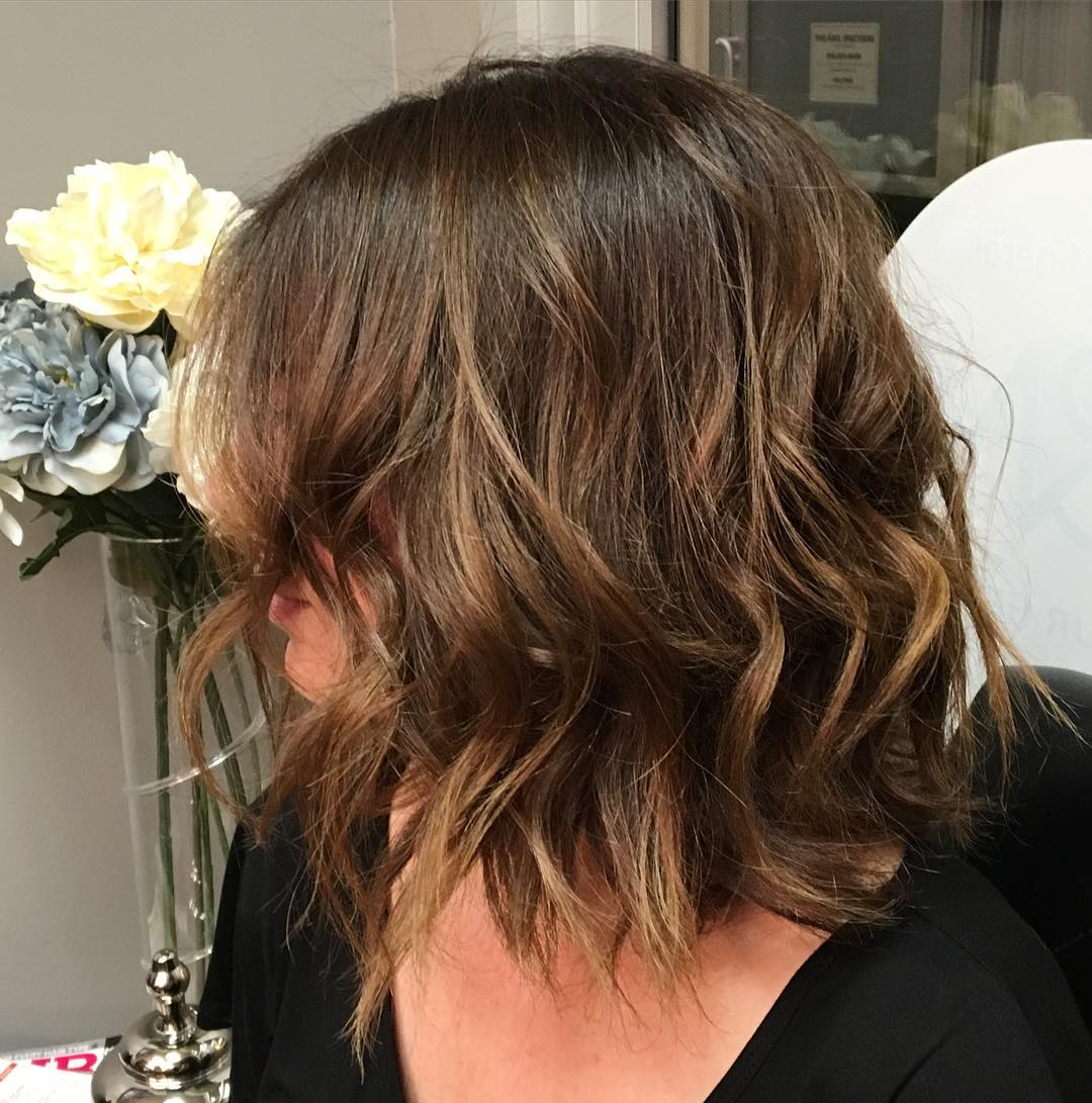 brown colored shoulder length shag haircut
