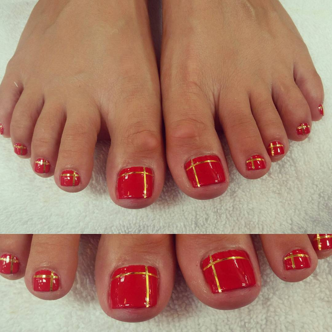 red and golden design nail art model