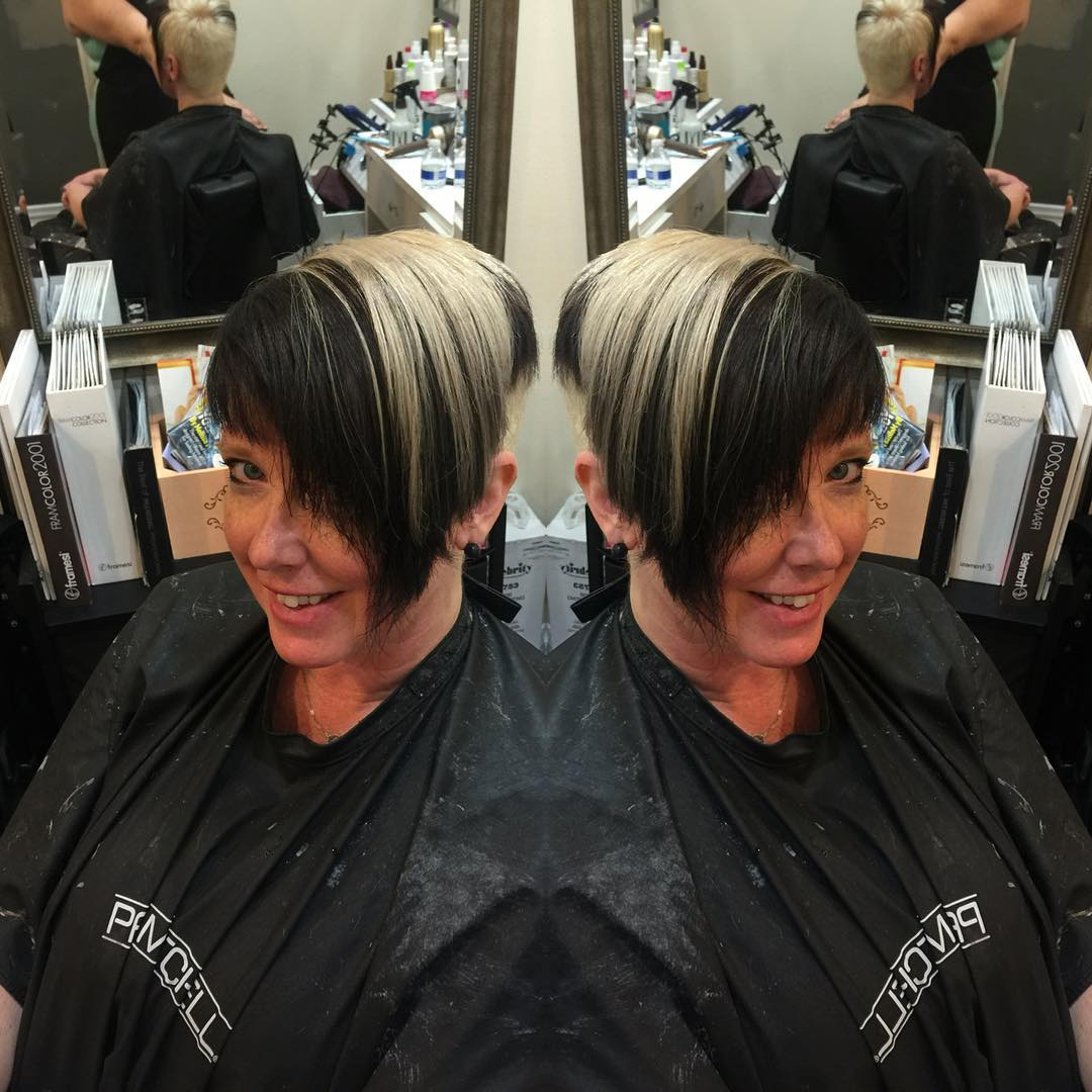 Small Bob Haircut With Heavy Side Bangs