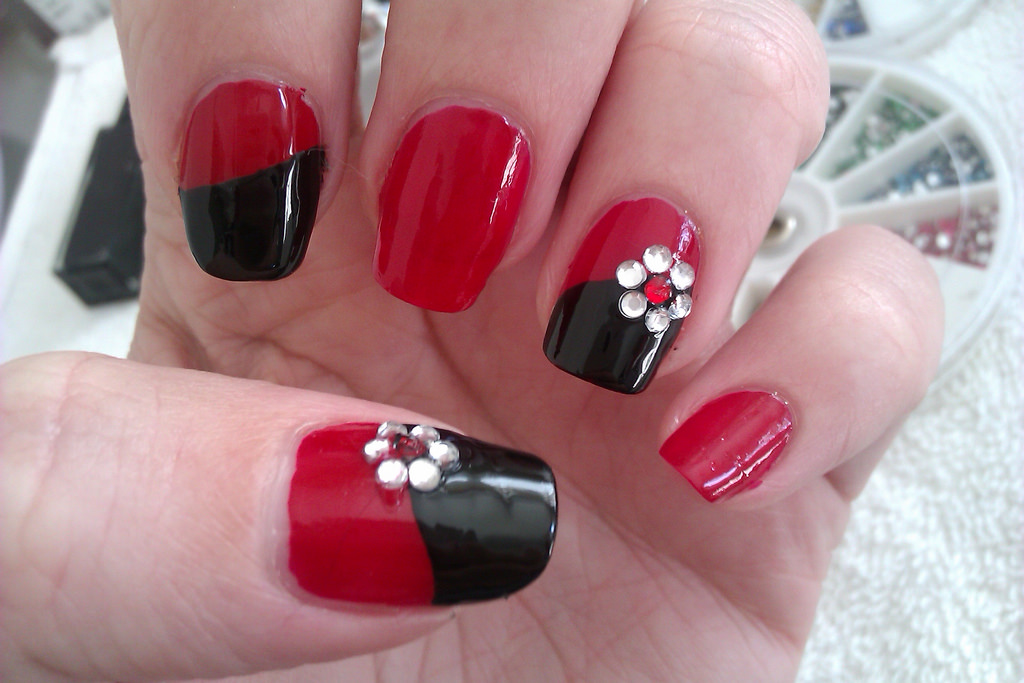 acrylic nail art design with rhinestone flowers