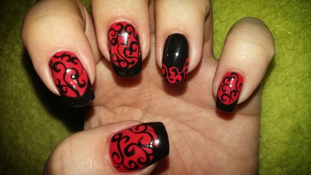 Swirling Dark Red Nail Design