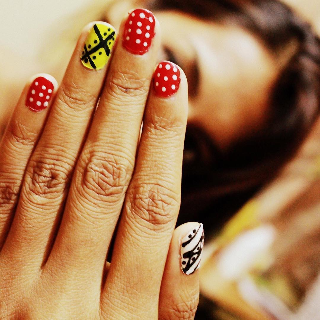 white dots design nail paint
