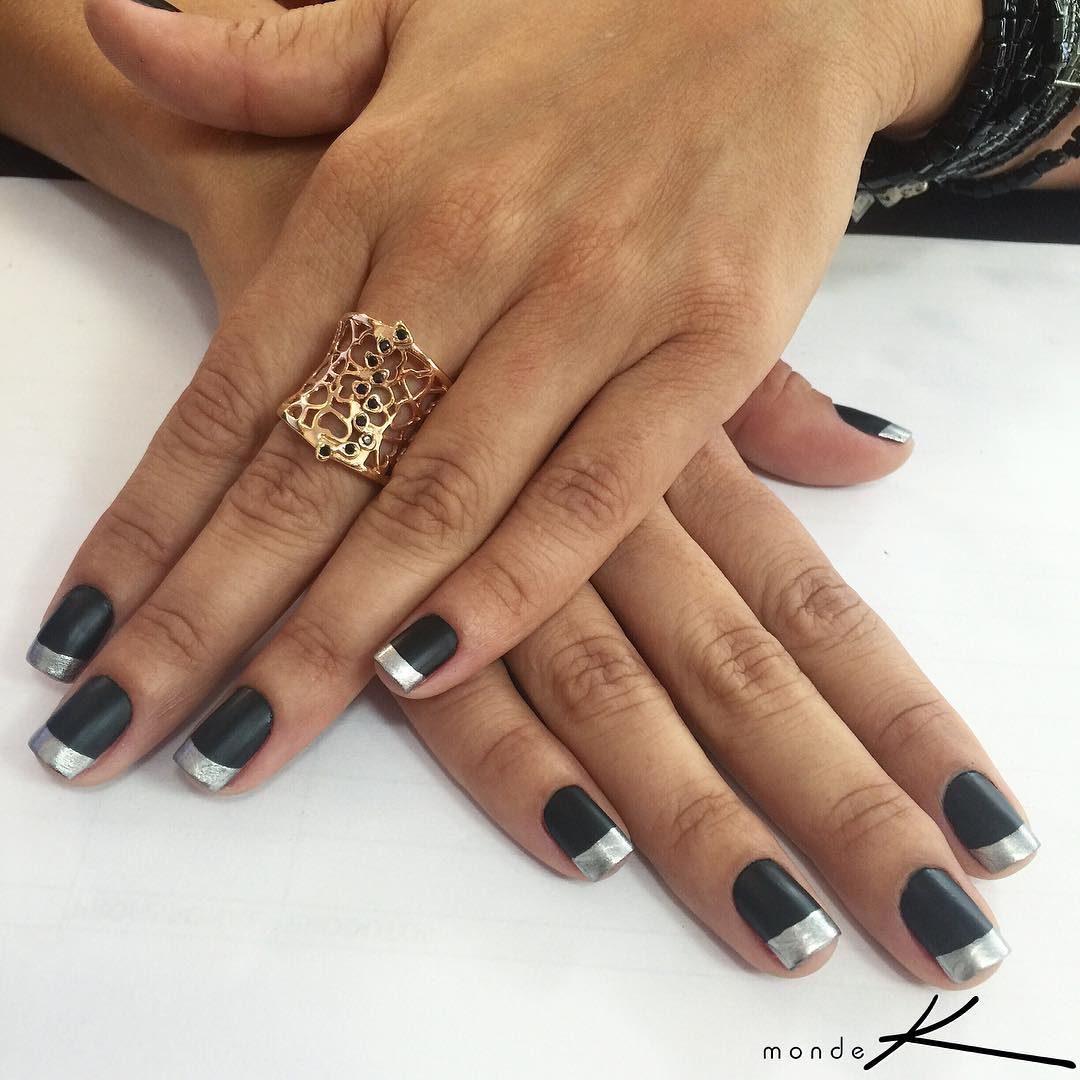 black nails with silver tip design