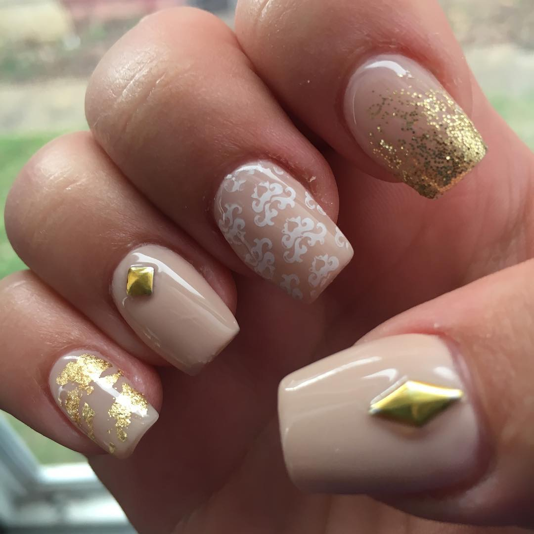 gold and white acrylic nail art design
