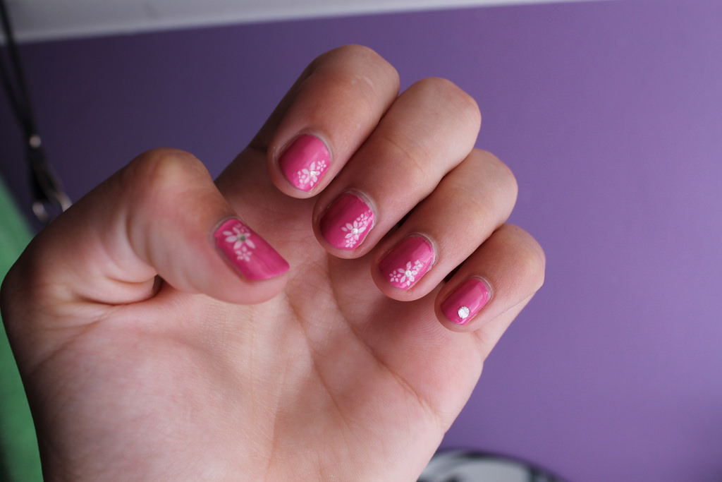 White Flowers Design On Pink Nails