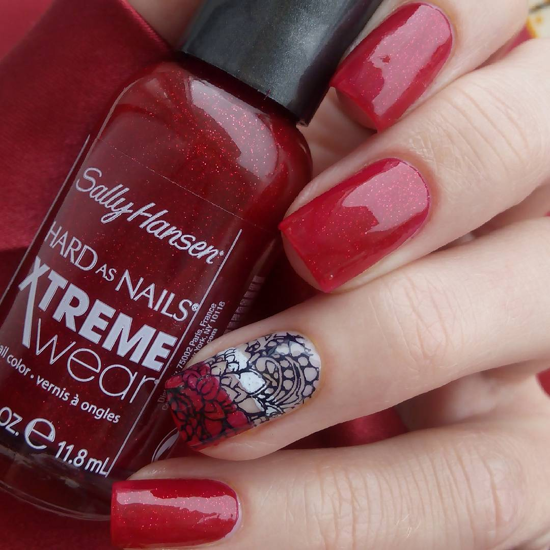 Red Nail Art Design With Swirlings