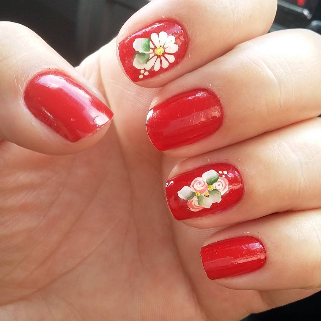 Red Nail Polish Design With Flowers.
