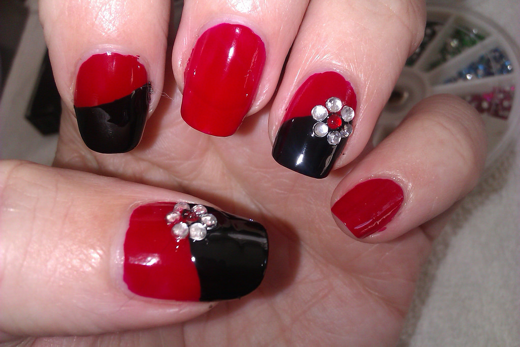 Simple Red And Black Nails With Rhinestone Flowers