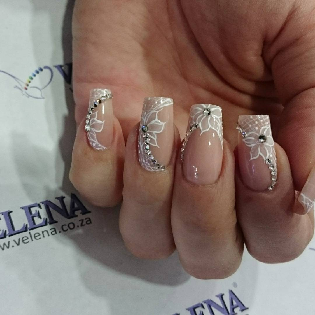 White Flowered Tip Nail Design