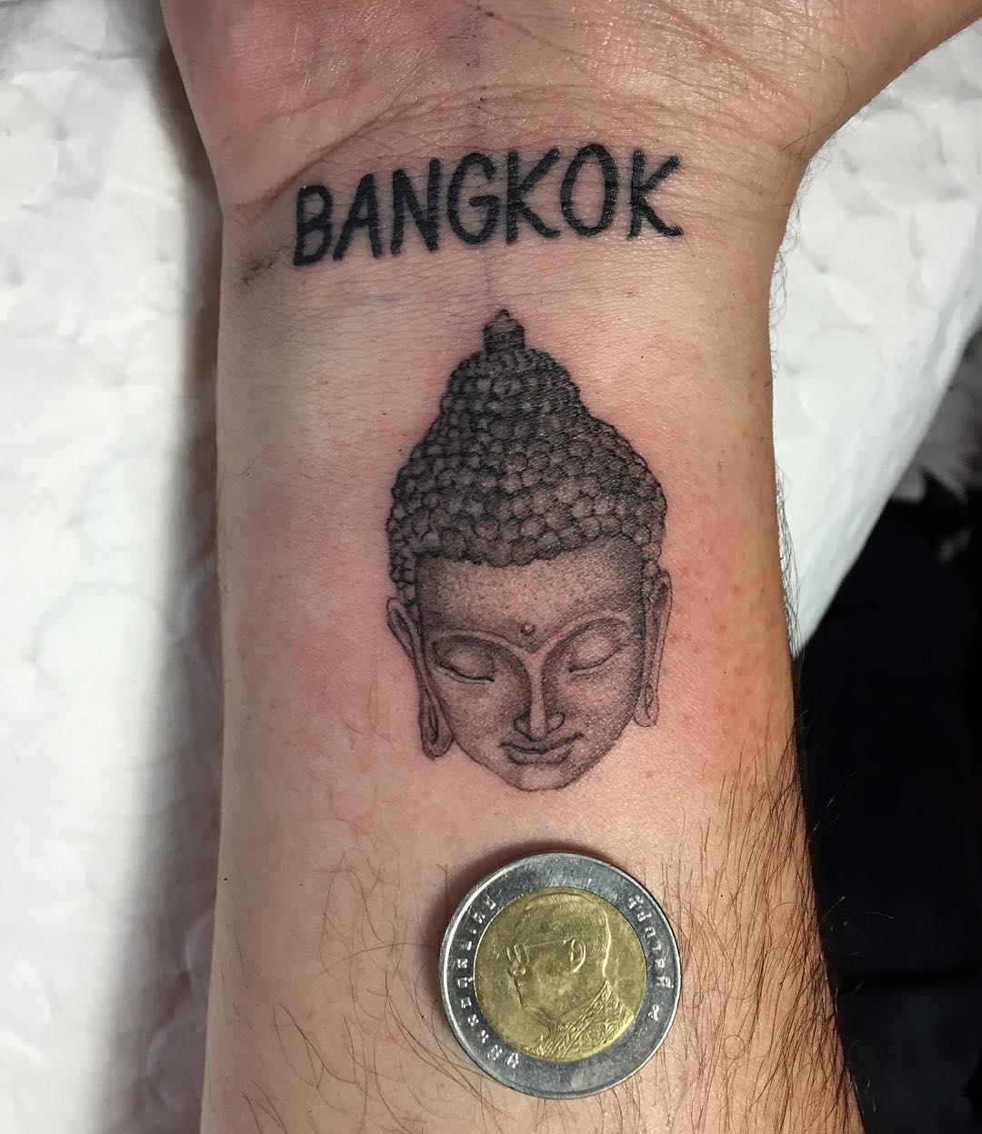 creative buddha head tattoo