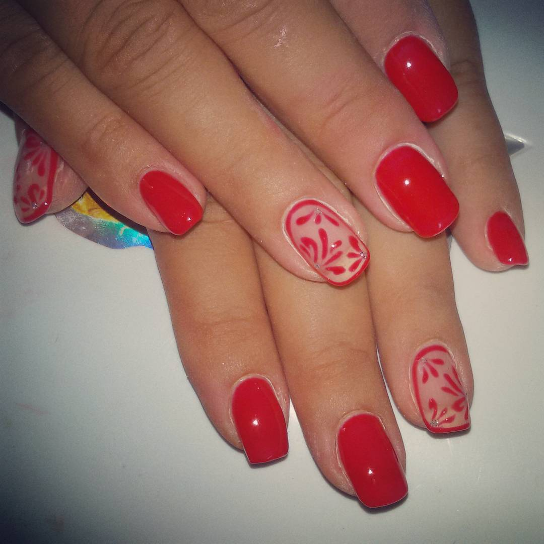 red colored sparkle nail design