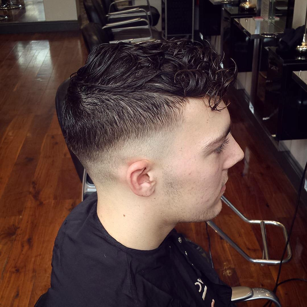 Faux Hawk Haircut With Low Fade