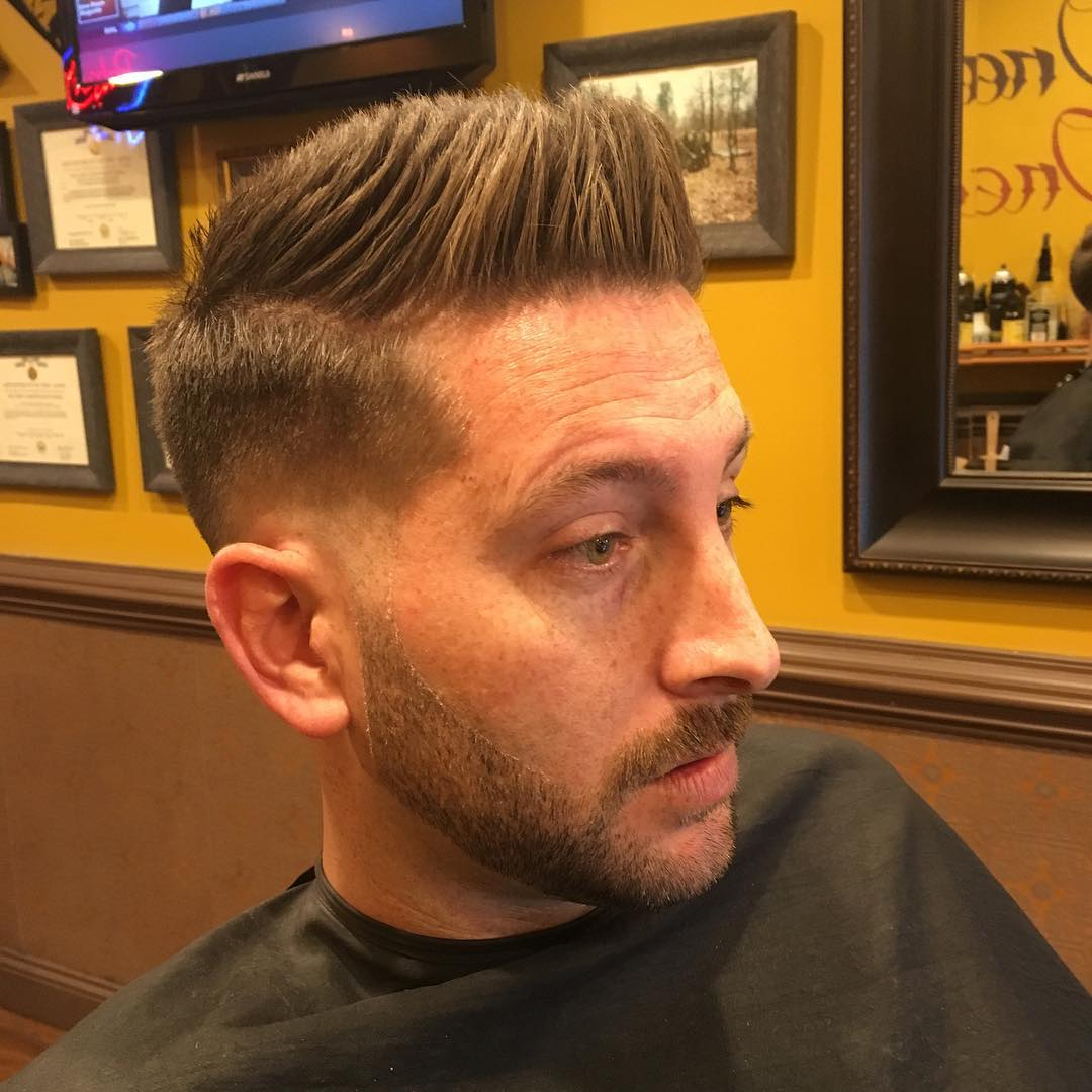Front Raised Textured Fade Haircut Style