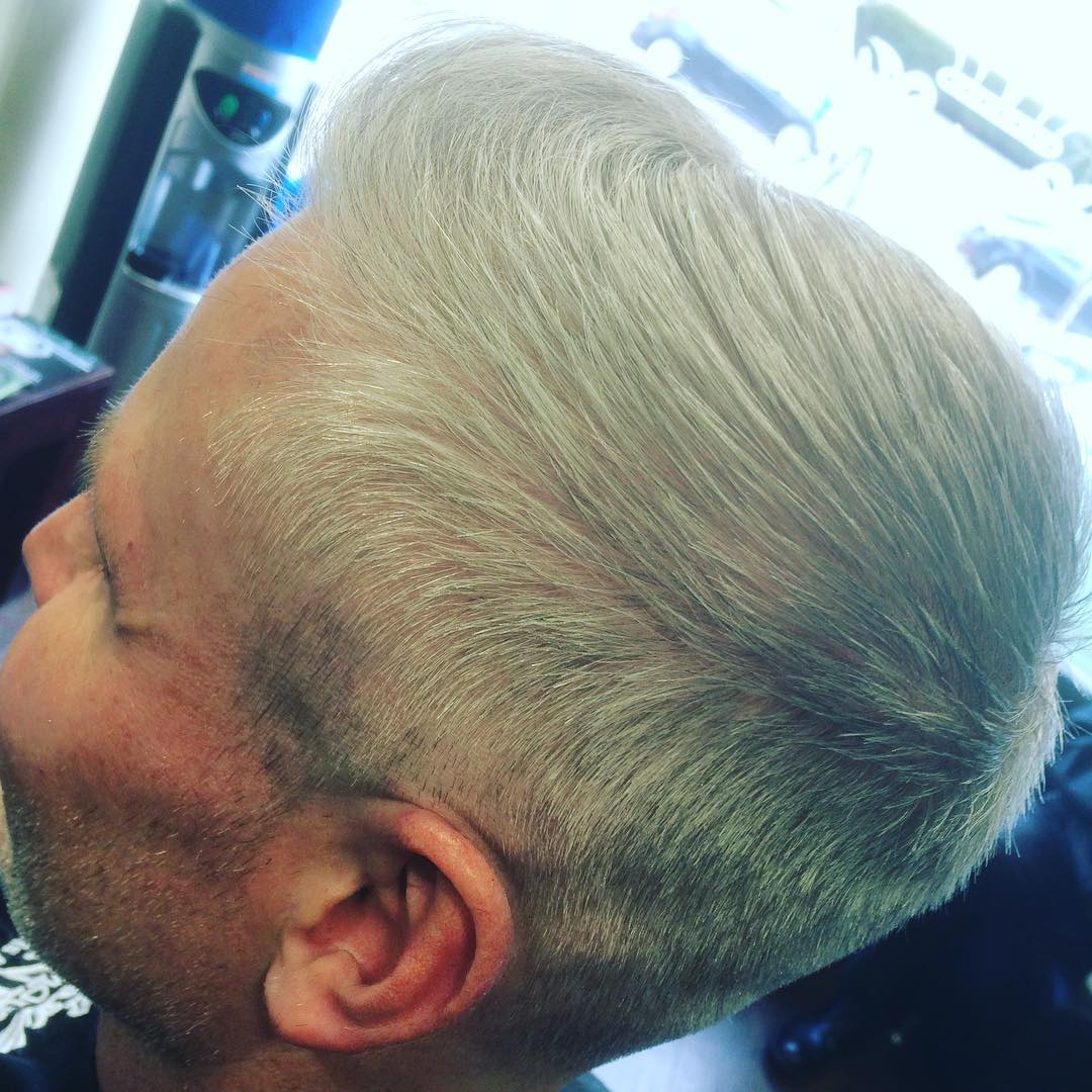 Comb Over Hairstyle With Low Fade For Old Man.