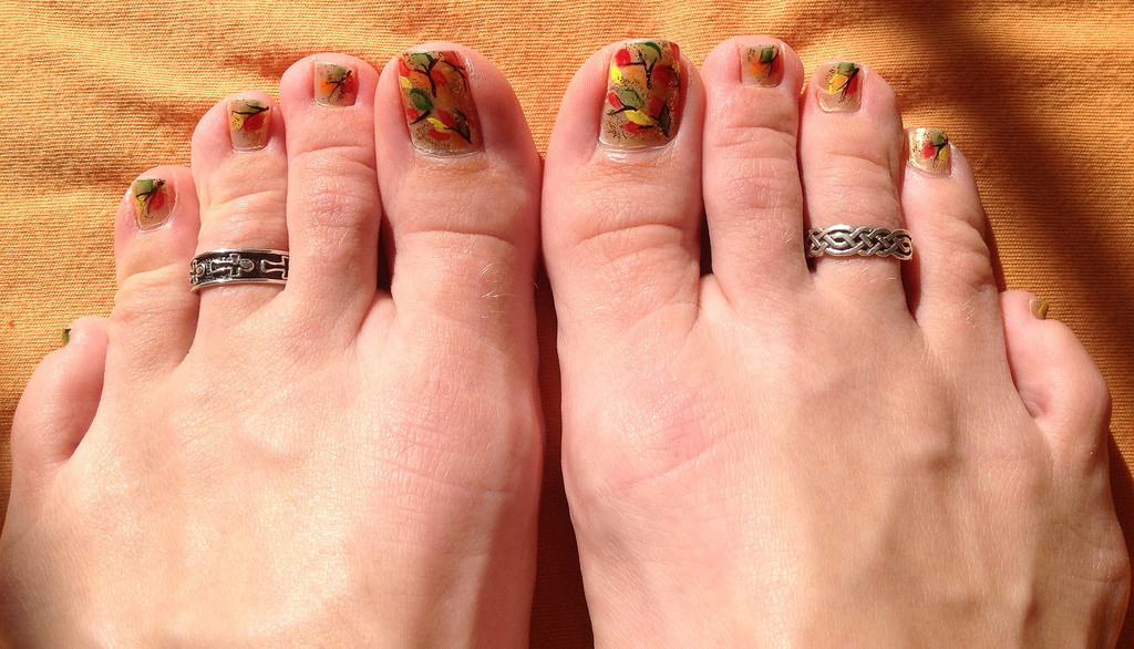 multi colored leaves toe nail art