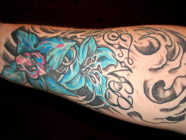 Colorful tattoo design on forearm