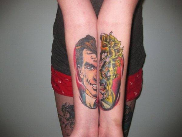 Two faced forearm tattoo design