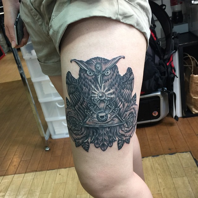 Owl designed tattoo in thigh