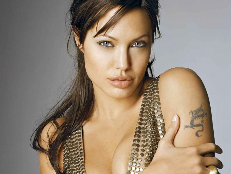 Angelina Jolie dragon fly tattoo on sholder
