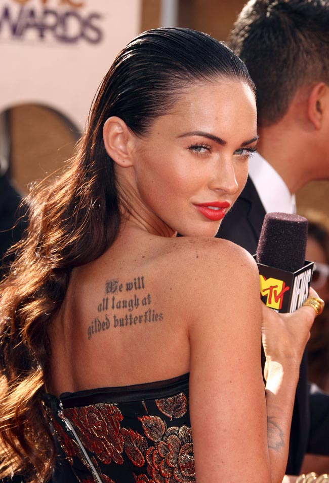 Megan Fox tattooed on right back shoulder