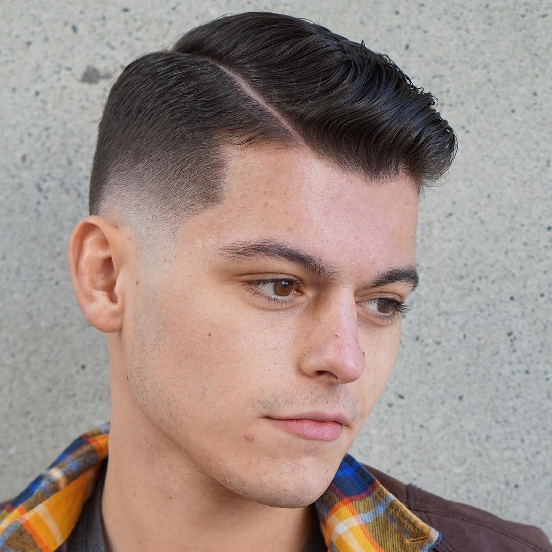 Low Skin Fade With Hard Part Hairstyle