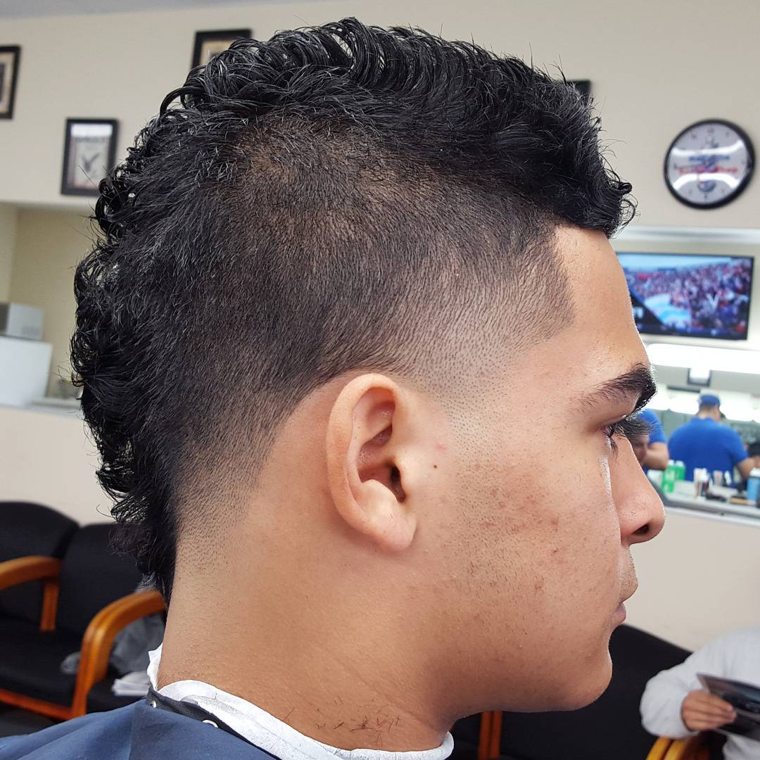 Mohawk Hairstyle With Side Taper Fade.