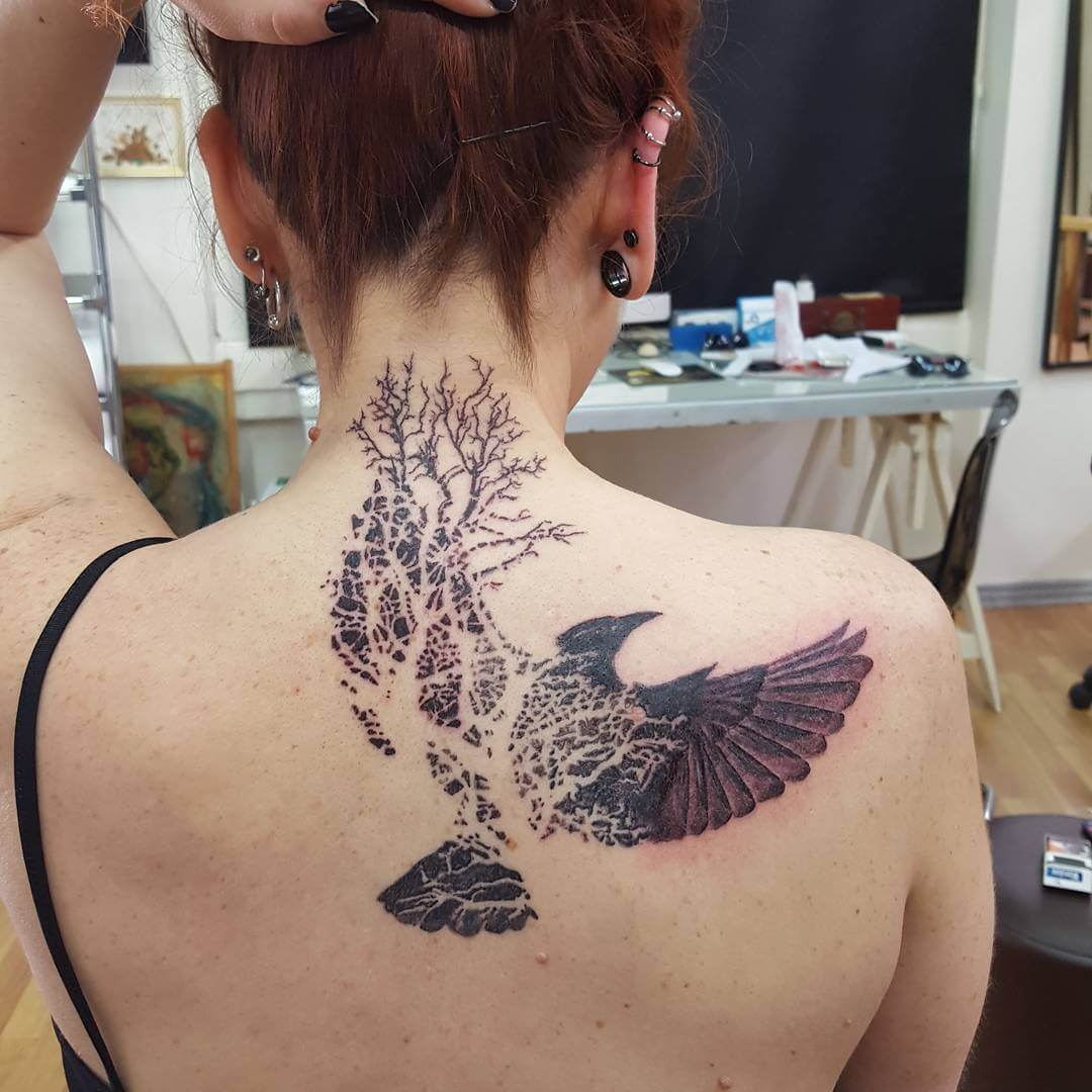 awesome crow tattoo design with tree