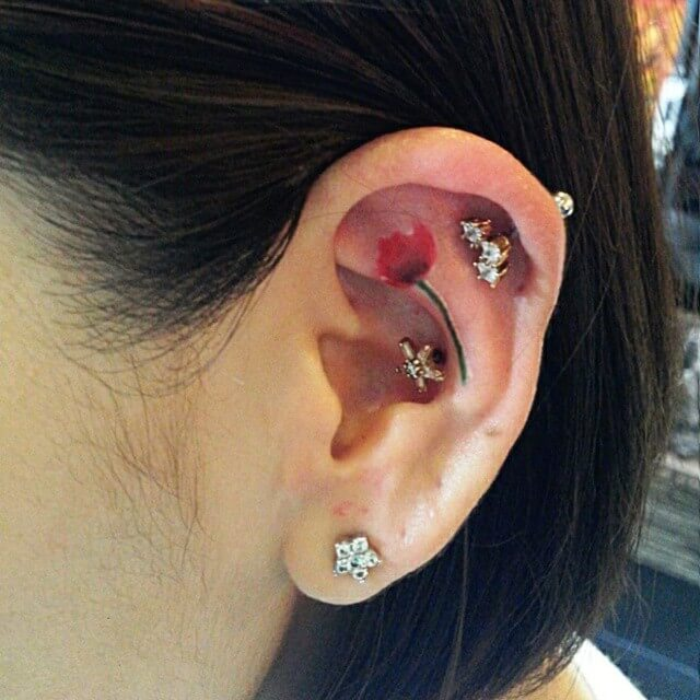 Cute Poppy Tattoo on Ear (1)