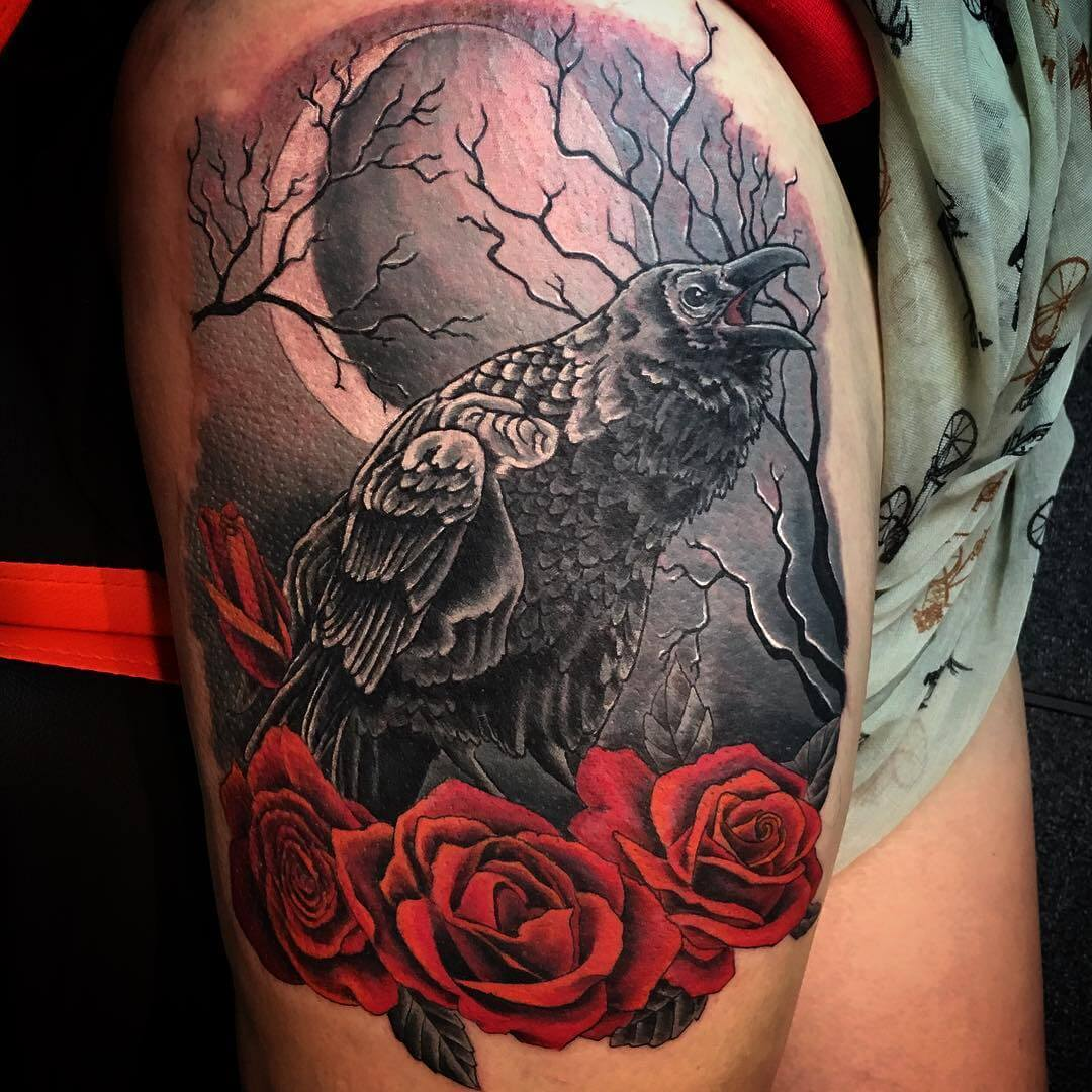 fabulous crow tattoo with red roses