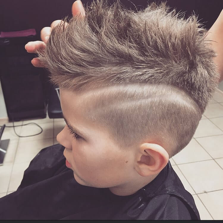 Top Raised Mohawk Haircut With Fade