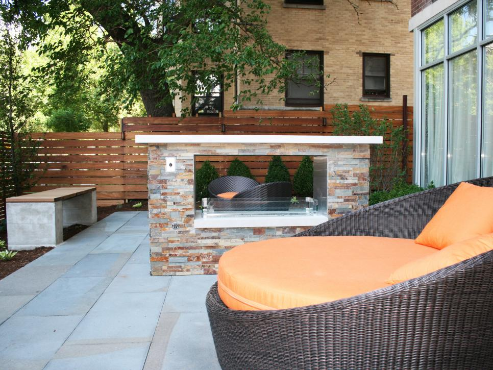 Features round wicker lounge chairs with orange cushions