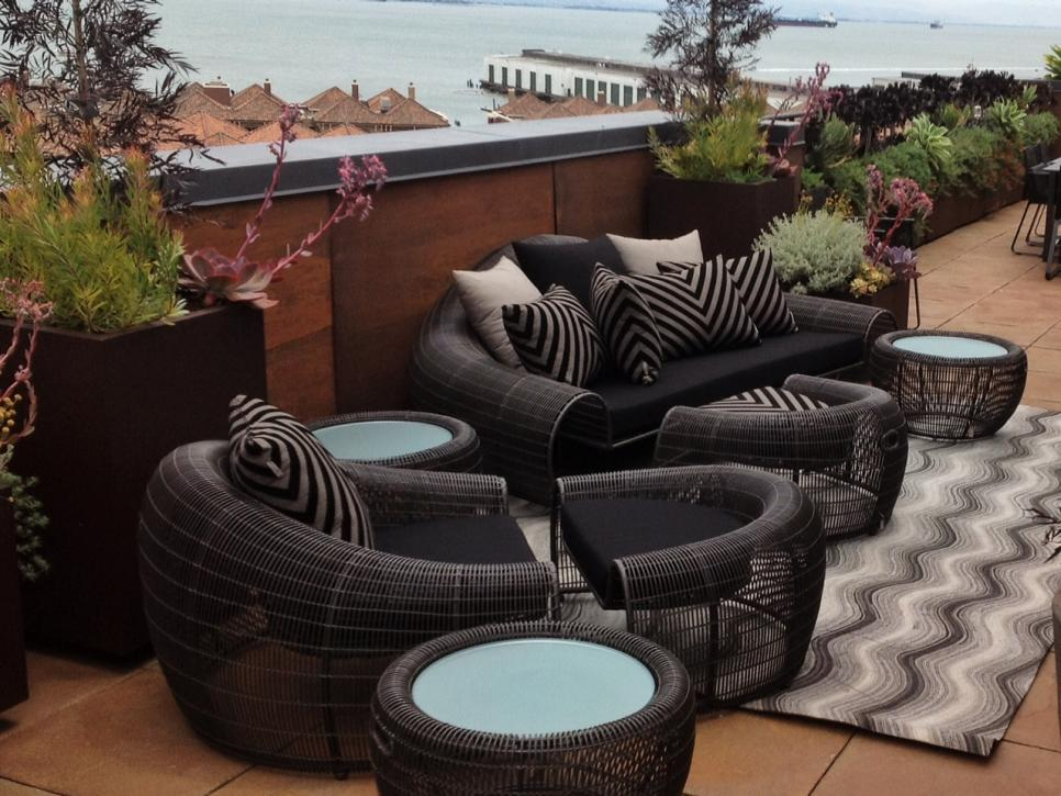 Contemporary Rug and Wicker Furniture on Rooftop Deck