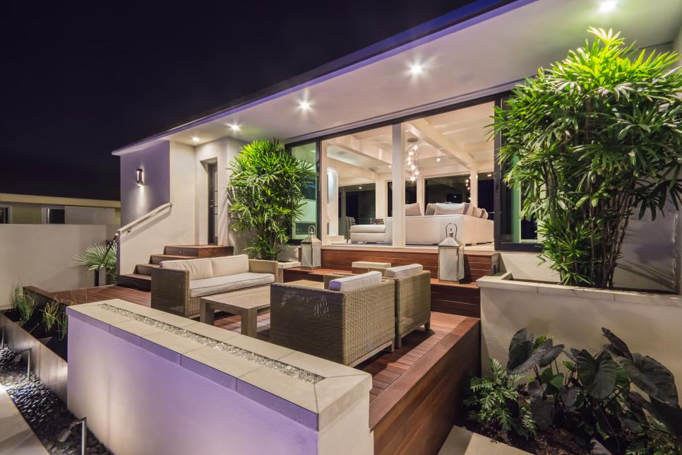 Contemporary Wood Deck With Light Wicker Outdoor Furniture