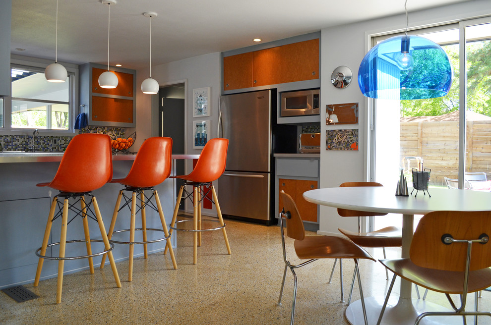 midcentury kitchen with elegant chairs