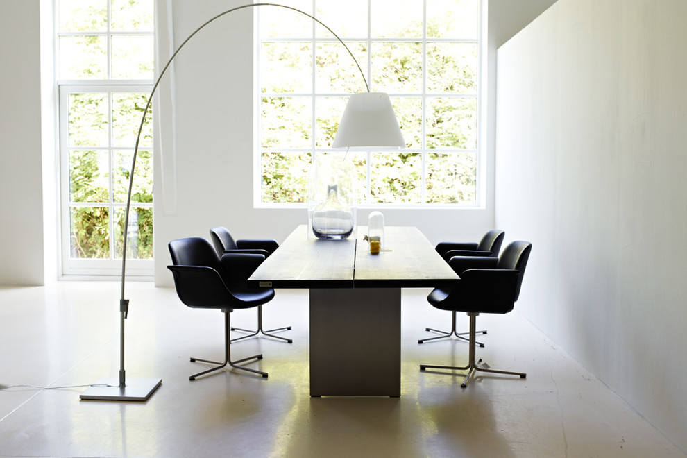 spaceous dining room with black wood table